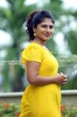 Ambily Nair in yellow dress stills (30)