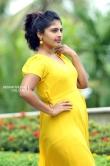 Ambily Nair in yellow dress stills (31)