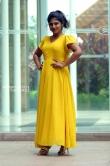 Ambily Nair in yellow dress stills (33)