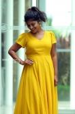 Ambily Nair in yellow dress stills (34)