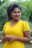 Ambily Nair in yellow dress stills (43)