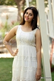 surabhi-in-white-dress-during-latest-photo-shoot-76185