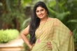 Anchor Sonia Chowdary in green saree stills (23)